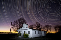 Star Trails Over An Abandoned Church